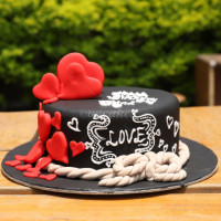 <p>This single deck cake baked with black fondant icing which is an ultimate occasion cake to express your love towards loved ones. To add more to design 2D hearts are topped. Write your message to your loved ones at the top of the cake. This beautiful indulgence will be the star of any special celebration. FREE HOME DELIVERY*. All cakes are baked with hygiene and quality in the top of our priority at our own state-of-the-art baking facility and quality checked twice by our expert QC team before delivery. You can send cakes or gifts to your loved ones in Nepal or shop online for yourself in Nepal with UG Bazaar, a pioneer in online shopping in Nepal.</p>